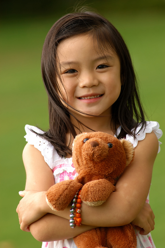 Young girl with teddy bear