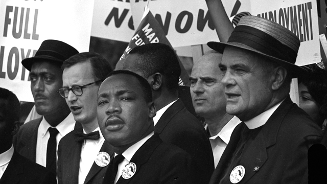 Martin Luther King Jr leading the head of the March.