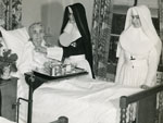 Sisters of Mercy in a hospital room