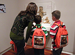 The Family Backpack Program helps families engage with artwork