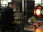 Nate Freeland of Neusole Glassworks in Cincinnati demonstrates the art of glassblowing