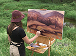 Abstract landscape painter Laura Leigh Lanchantin works en plein air in the Catskill Mountains