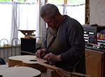 Dayton guitar maker Gearld Strickland builds the sound of music