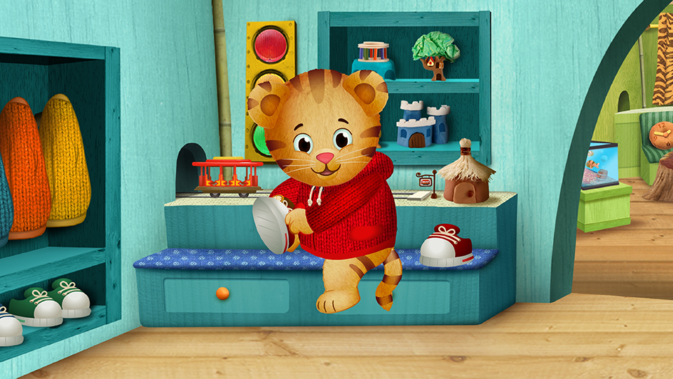 Daniel Tiger putting on his shoes in a scene from 'Daniel Tiger's Neighborhood.'