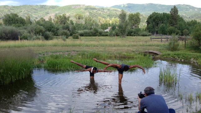Dance students pose for a picture in the pond on campus at Perry-Mansfield