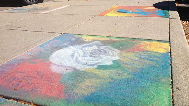 Artists create work on Loveland sidewalks unrelated to the topic of domestic violence, even though the event Pastels on 5th raises money for increased awareness of prevention and support for victims.