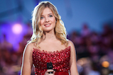 Classical crossover star Jackie Evancho performs at <em>A Capitol Fourth</em> concert at the U.S. Capitol, West Lawn, on July 4, 2016 in Washington, DC.