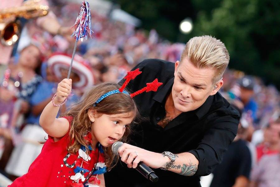 Mark McGrath of Sugar Ray performs with a young member of the audience at <em>A Capitol Fourth</em> at U.S. Capitol, West Lawn on July 4, 2017 in Washington, DC. (Photo by Paul Morigi/Getty Images for Capital Concerts)