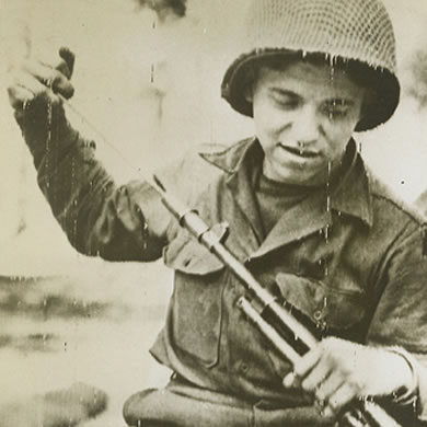 Soldier loading a rifle