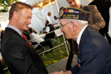Gary Sinise (R) greets a WWII veteran backstage at the 25th annual National Memorial Day Concert on the West Lawn of the U.S. Capitol, May 25, 2014, in Washington, DC.