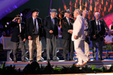 Gerald McRaney shakes hands with WWII veterans attending the 25th annual National Memorial Day Concert on the West Lawn of the U.S. Capitol, May 25, 2014, in Washington, DC.