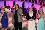 "(L to R) Megan Hilty, Caleb Johnson, Dianne Wiest and Jackie Evancho onstage for the 25th National Memorial Day Concert finale performance, ""God Bless America."""