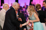 Gen. Colin Powell shakes hands with Jackie Evancho during the 25th annual National Memorial Day Concert finale on the West Lawn of the U.S. Capitol, May 25, 2014, in Washington, DC.