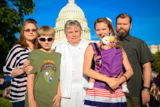 The Stonesifer family poses for a picture before the 25th National Memorial Day Concert on the West Lawn of the U.S. Capitol, May 25, 2014, in Washington, DC.