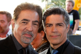 Host Joe Mantegna and actor Esai Morales pose together backstage at the 2015 National Memorial Day Concert.