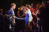Actors Jason Dolley and Stefanie Scott greet honorees Cameron and Bayleigh Dostie on the 2015 National Memorial Day Concert.