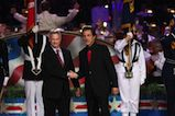 Actors and co-hosts Gary Sinise and Joe Mantegna shake hands onstage at the 27th <em>National Memorial Day Concert</em>.
