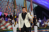 <em>American Idol</em> Season 15 winner Trent Harmon performs the national anthem at the 27th <em>National Memorial Day Concert</em>.