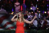 "Katharine McPhee performs ""America, the Beautiful"" at the 27th <em>National Memorial Day Concert</em>."