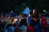Actress S. Epatha Merkerson (R) gives a hug to Gold Star mother Paula Davis after paying tribute to her son, Army Private First Class Justin R. Davis, who was killed in Afghanistan, at the 27th <em>National Memorial Day Concert</em>.