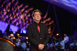 Actor and co-host Joe Mantegna pays tribute to Battle of Anzio veteran Alton W. Knappenberger at the 27th <em>National Memorial Day Concert</em> on May 29, 2016 in Washington, DC.