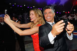 "Singer and actress Katharine McPhee and actor Esai Morales take ""selfies"" onstage at the 27th <em>National Memorial Day Concert</em> on May 29, 2016 in Washington, DC."