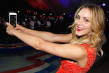 "Singer and actress Katharine McPhee takes a ""selfie"" onstage at the 27th <em>National Memorial Day Concert</em> on May 29, 2016 in Washington, DC."