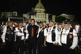 Co-host Joe Mantegna poses with Vietnam veterans in the crowd at the 27th <em>National Memorial Day Concert</em>.