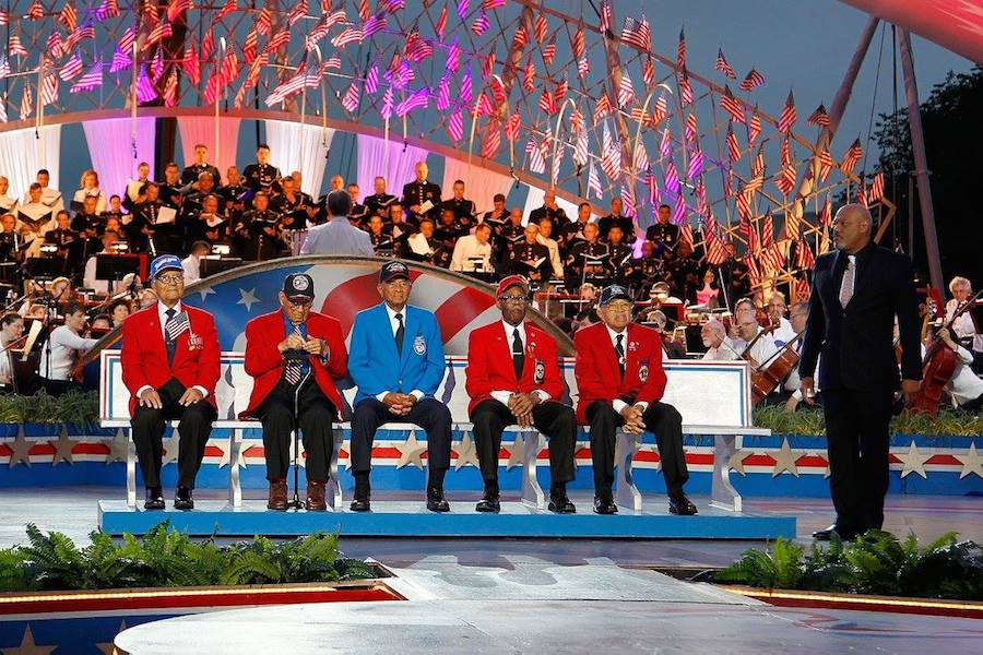 Host Laurence Fishburne (R) pays tribute to members of The Tuskegee Airmen at PBS' 2017 <em>National Memorial Day Concert</em> at U.S. Capitol, West Lawn on May 28, 2017 in Washington, DC. (Photo by Paul Morigi/Getty Images for Capital Concerts)