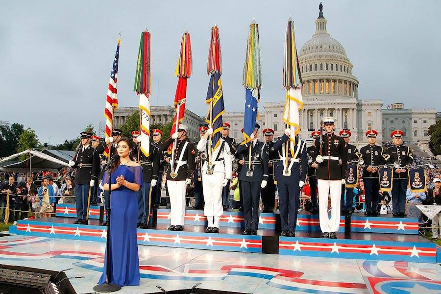 """Auli'i Cravalho of the hit Disney film """"Moana"""" performs the """"U.S. National Anthem"""" at PBS' 2017 <em>National Memorial Day Concert</em> at U.S. Capitol, West Lawn on May 28, 2017 in Washington, DC. (Photo by Paul Morigi/Getty Images for Capital Concerts)"""