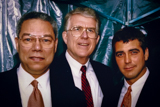 Gen. Colin Powell, Executive Producer Jerry Colbert and George Clooney TALK backstage at the 1995 <i>National Memorial Day Concert</i>.