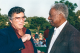 Burt Reynolds, whose father was in the U.S. Army, and Ossie Davis, a veteran of World War II, talk backstage at the 1996 <i>National Memorial Day Concert</i>.