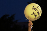 Caitlin Wachs and Dana Palmer release a balloon message in memory of Dana's father, a firefighter killed in the Sept. 11 attacks.