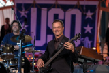 Gary Sinise performs on the National Memorial Day Concert with the Lt. Dan Band.