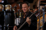 Gary Sinise plays bass in the Lt. Dan Band on the <i>National Memorial Day Concert</i>.