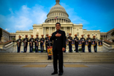 Joe Mantegna stands on the steps of the U.S. Capitol with the U.S. Army Herald Trumpets at the <i>National Memorial Day Concert</i>.