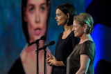 Dianne Wiest and Katie Holmes embrace the family of wounded veteran Jose Pequeno on the 2009 <i>National Memorial Day Concert</i>.