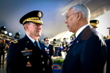 Gen. Colin Powell and Gen. Martin Dempsey speak on the set of the <i>National Memorial Day Concert</i>.