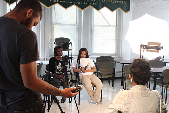High school students working together at a youth media workshop in Baltimore City.