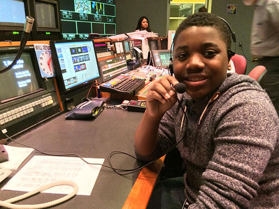 Baltimore teenage boy working in a studio to develop a youth media project for American Graduate.