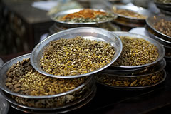 dried herbs on metal platters