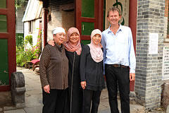 Michael Wood standing with 3 women