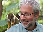 Neil Shubin interacts with a squirrel monkey; our many shared features are evidence of a common ancestor that lived relatively recently.