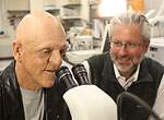 Michael Berryman, left, and Neil Shubin look at some fossils that shed light on the evolutionary origin of conditions known as ectodermal dysplasias.