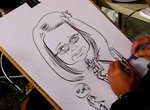 Caricature artist Two Handed Mikey draws portraits using both hands at the same time.