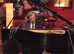 John Covelli has mastered the talent of both performing and conducting at the same time